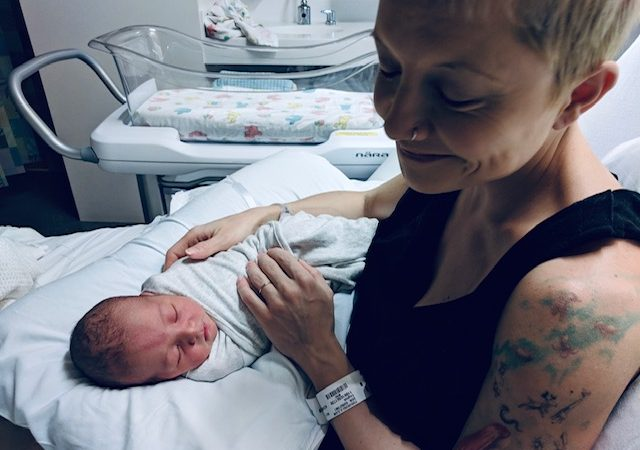 a new born and the mum, in the hospital