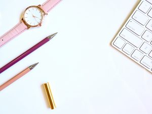 keyboard, two pens and a watch