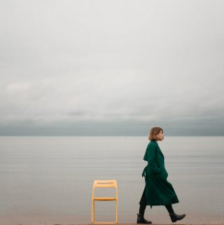 a woman, alone, on the beach.