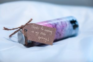 "little gift jar with the note ""thanks for existing in my little galaxy"""