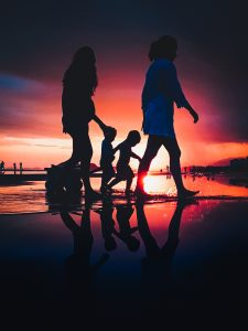a family seen at the sunset