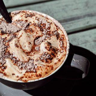 a cup of foamy drink