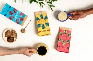 Rasa coffee substitutes, two hands holding coffee mugs
