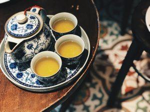 small, full tea cups