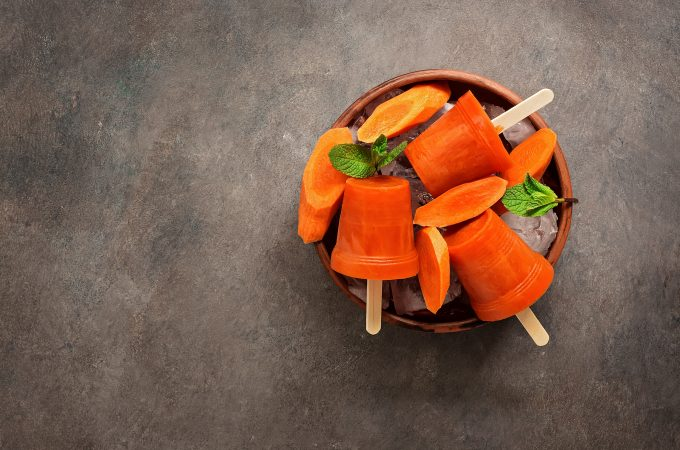 carrot popsicles in a bowl