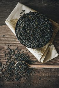 peppercorns in a bowl, on a wooden table