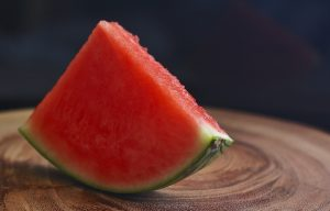 watermelon slice on a wooden surface