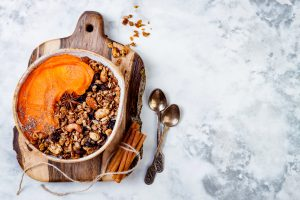 Pumpkin smoothie bowl topped with granola