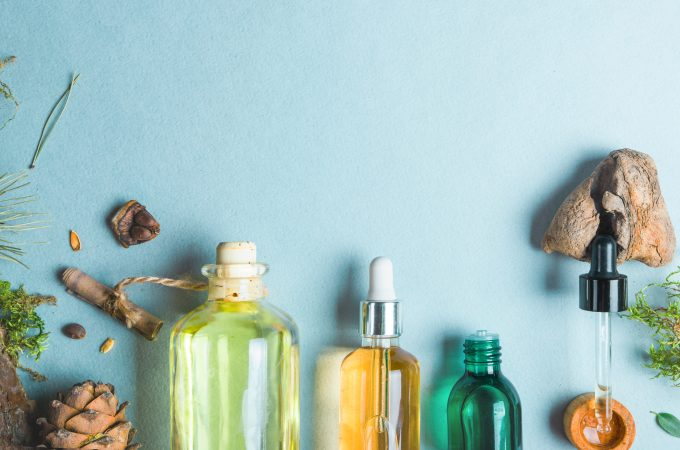 Homeopathic oils, dietary supplements for intestinal health Natural cosmetics, oils for skin care on a light background.